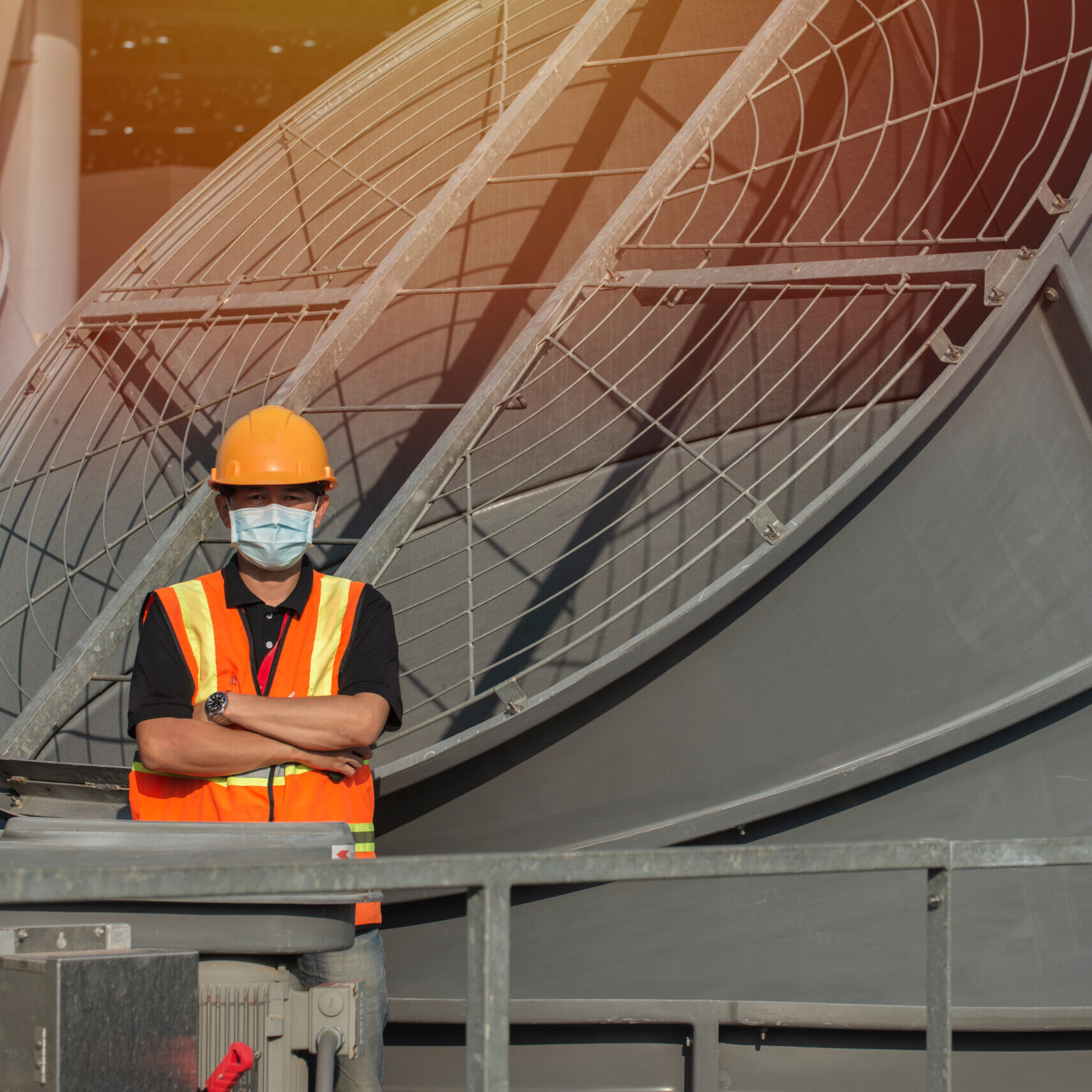 Portrait,Engineer,With,Cross,Arms,On,Cooling,Tower.,Engineer,People