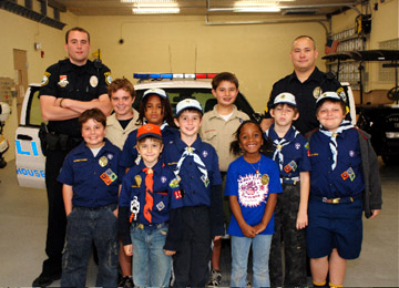 Wellington Cubscout Den 7 of Pack 125 are all smiles as they get the full tour from Sgt. Chris Oh and Officer Joe Esposito at the Light House Point Police Station in Light House Point Florida.