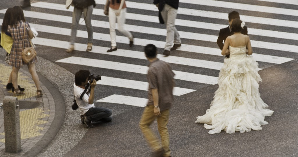 Young Couple at Shibuya Crossing. Tokyo, Japan         Photo: ©2013 Eric and Lori Baumel.