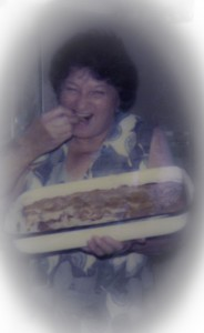 Fading photo: Grandma Rae and her apple pie. Circa: Late 1970's.