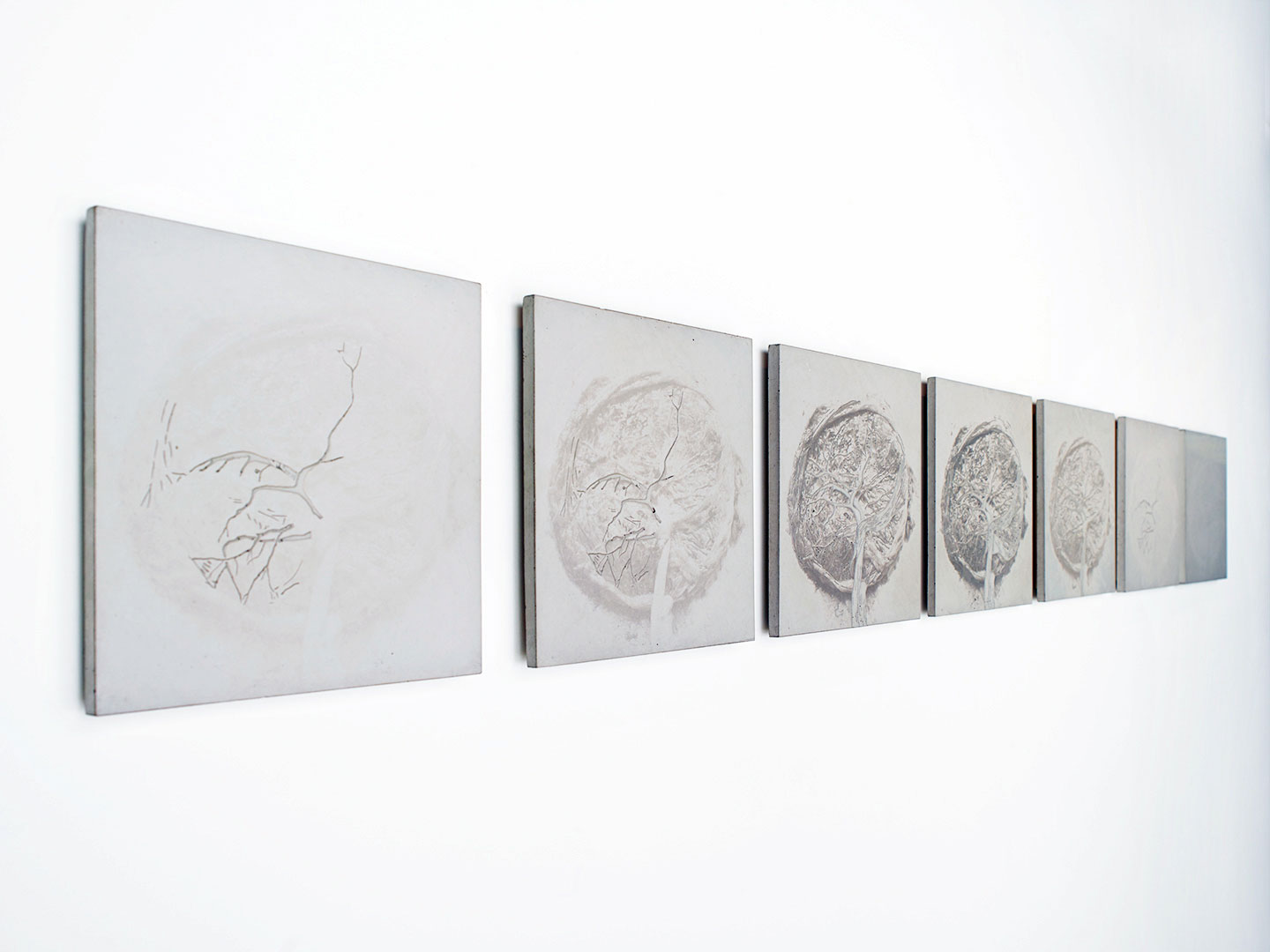 Wall sculptures of cement relief squares by Zoe Buckman on display at Garis & Hahn Gallery in New York City.