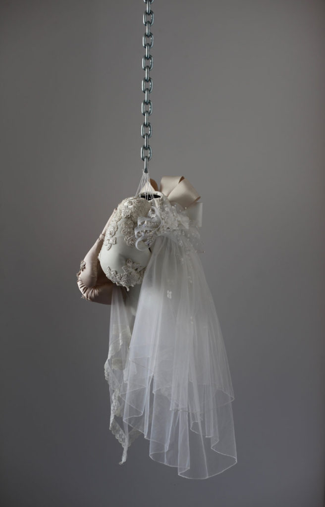 Boxing glove and wedding dress sculpture by Zoe Buckman