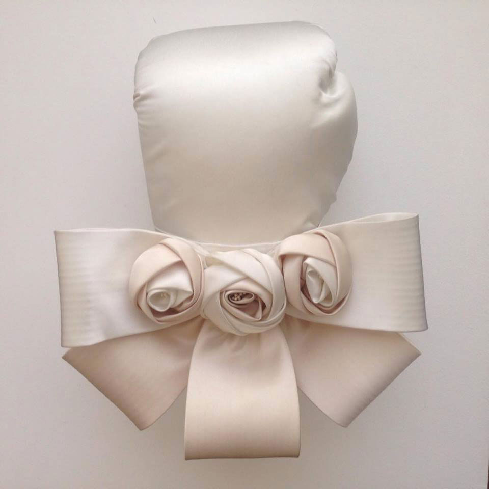 Bow and rosette boxing glove by Zoe Buckman