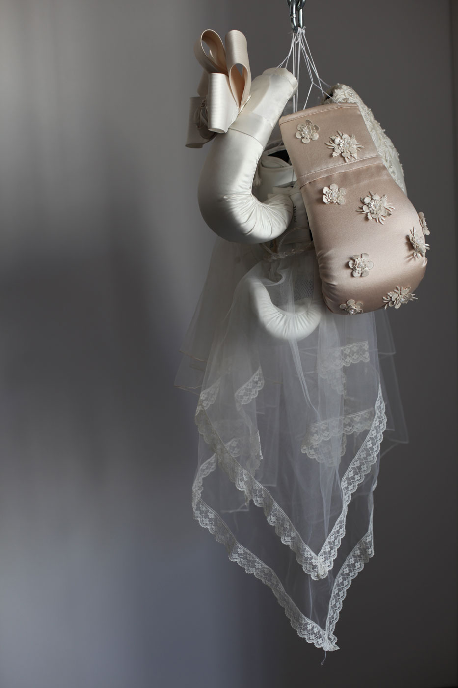 Wedding dresses cover boxing gloves in feminist sculpture