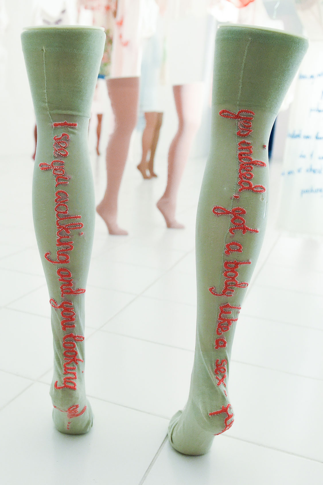 Embroidered vintage nylons with rap lyrics as sculpture