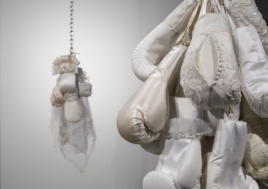 Punching bags made of wedding dresses as feminist fabric art