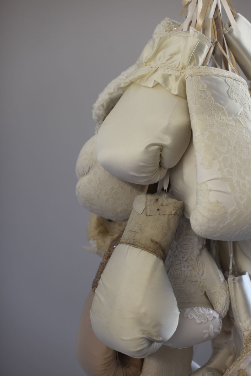 Contemporary fiber sculpture by feminist artist Zoe Buckman features boxing and weddings