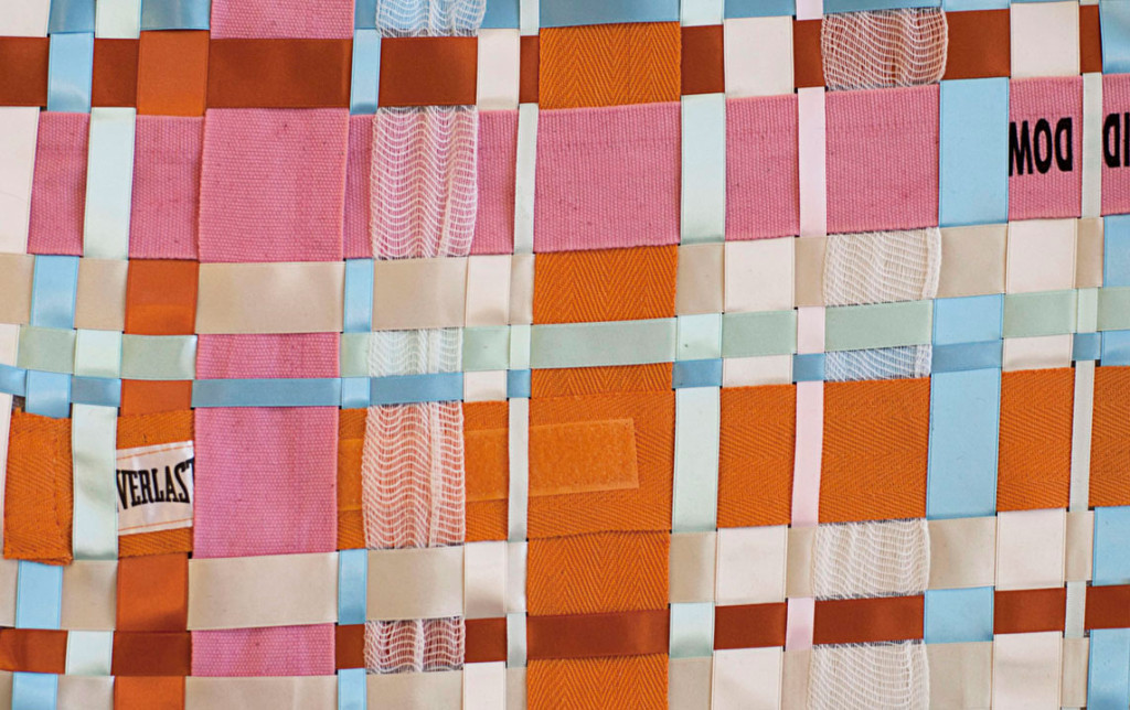 Woven fabric with gauze and boxing wraps as fabric feminist art by Zoe Buckman