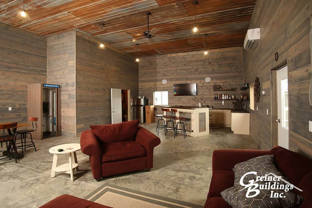 inside a finished man cave metal pole barn with wood walls and metal celing