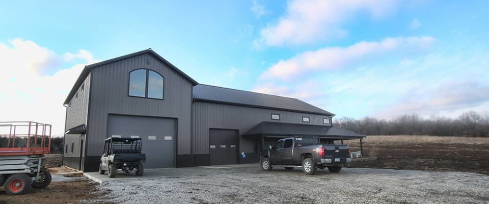 gray pole barn house with shop space