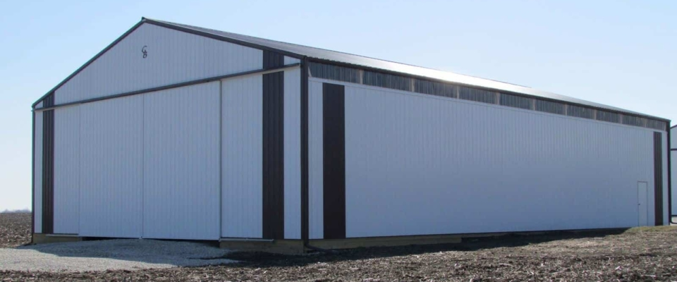 white machine shed with sliding doors