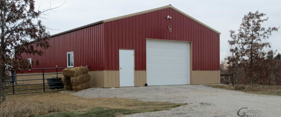 red and gold pole building livestock barn