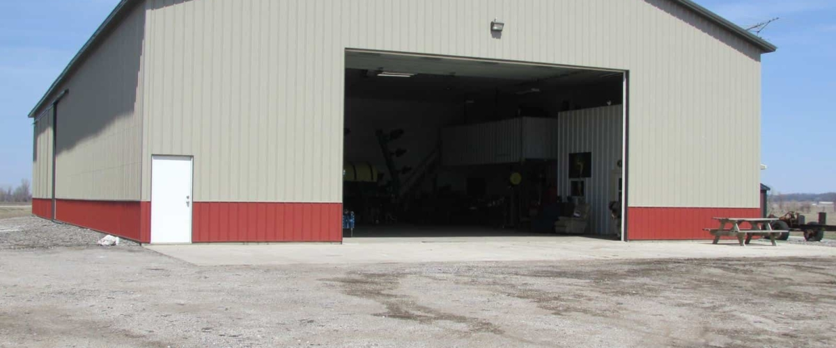 tan and red machine shed building