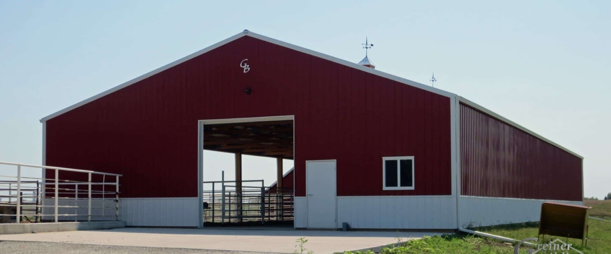 large red livestock post frame building in iowa