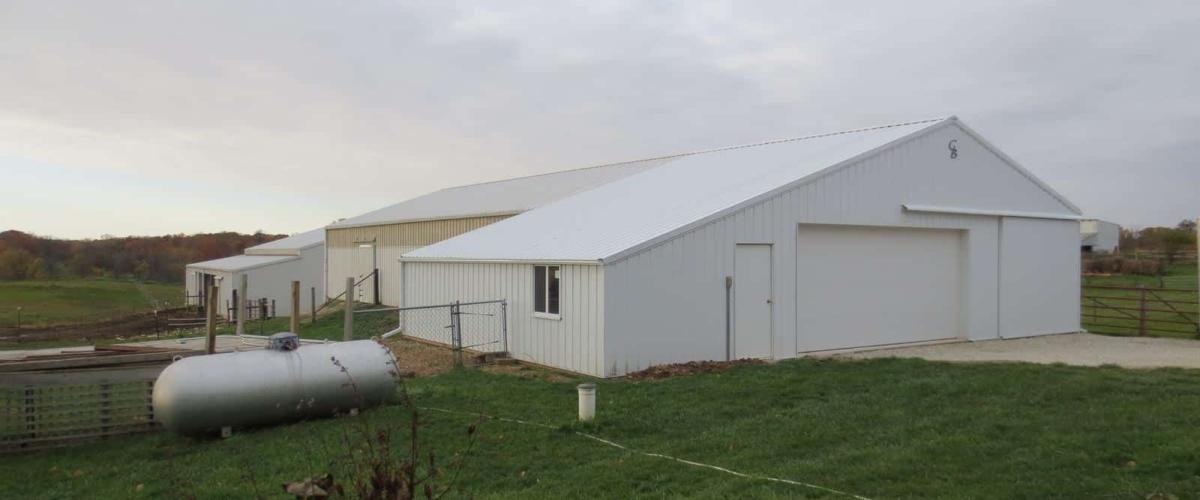 white post frame horse barn