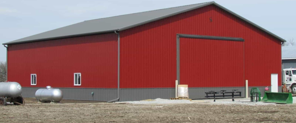 large red insulated ag building post frame