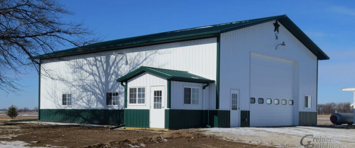large white and green insulated pole barn