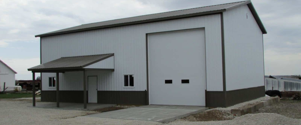 white pole barn garage tall door