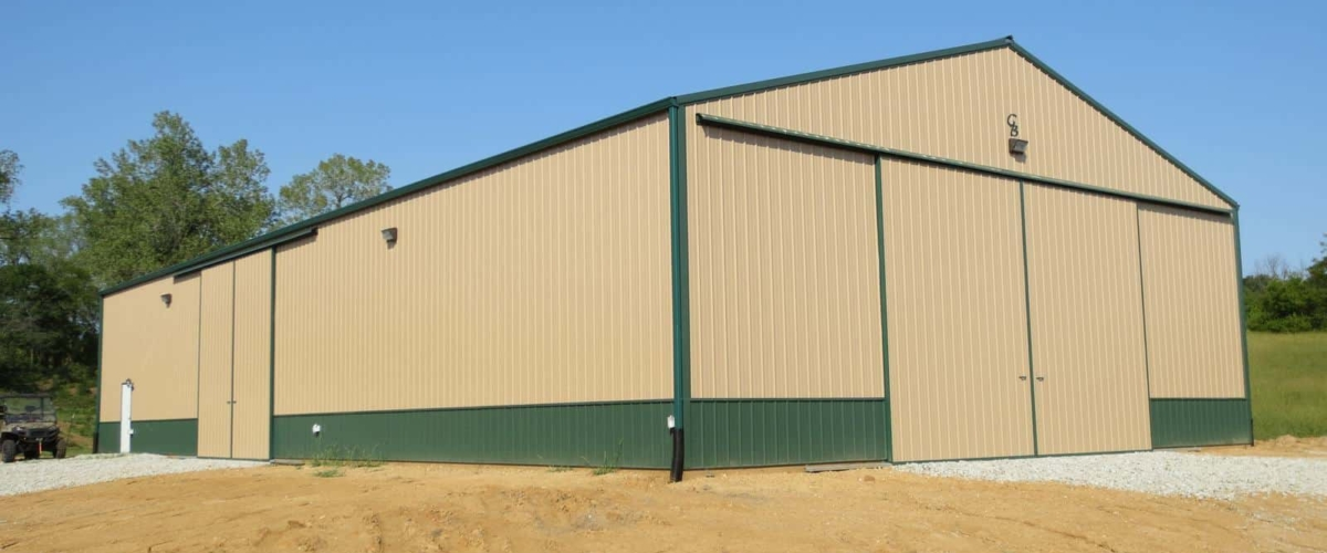 gold and green machine shed storage building