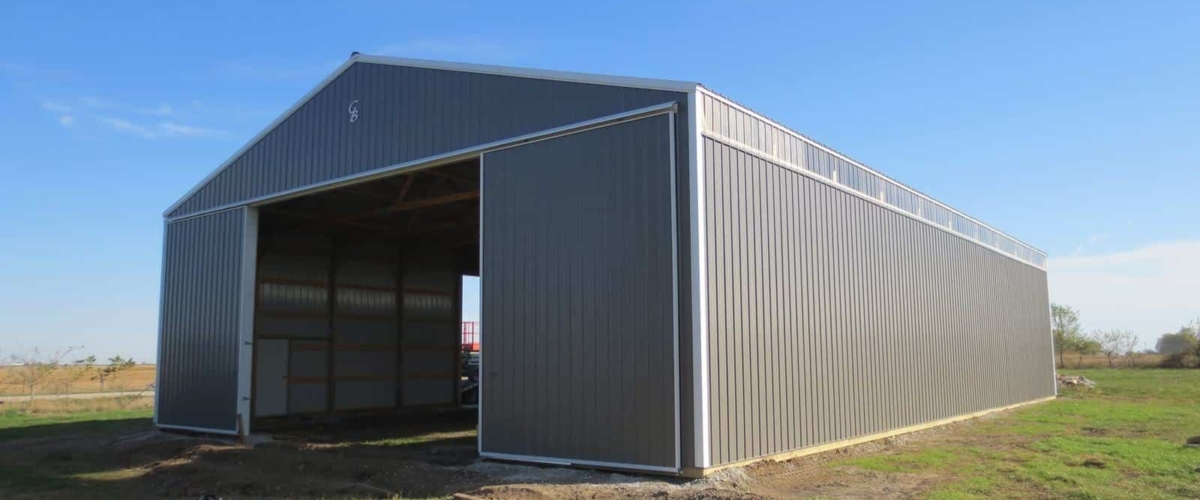 large gray pole building machine shed on farm
