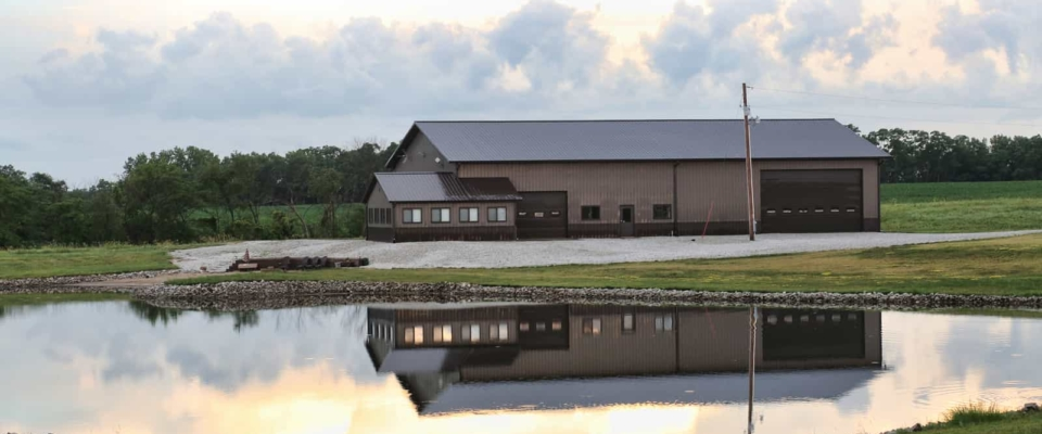award winning brown pole barn shop near lake