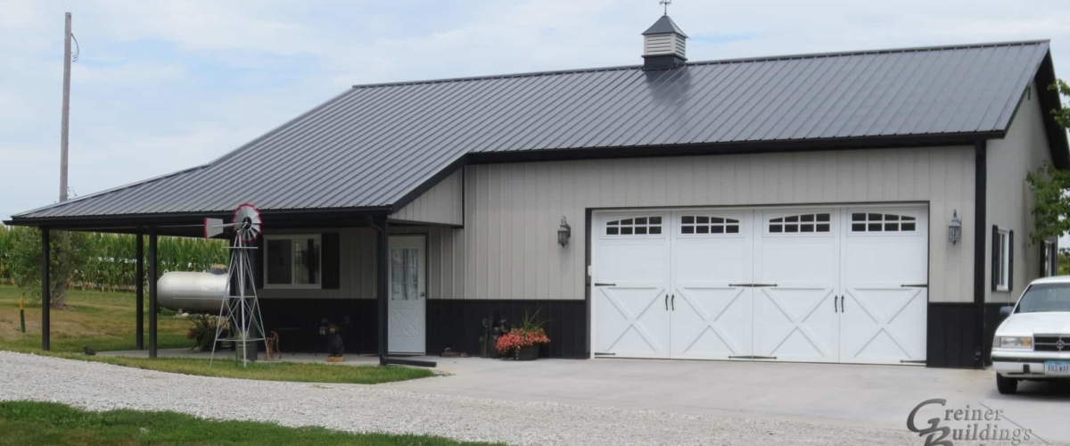 tan pole barn garage with white door