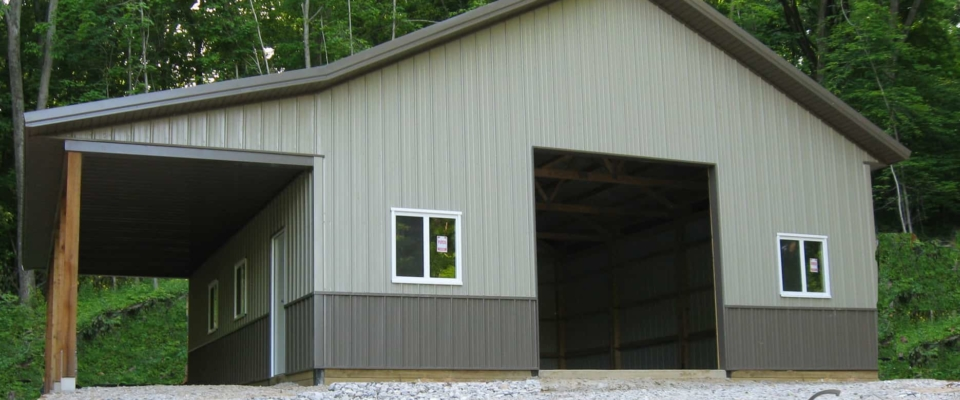 gray and brown pole barn garage new windows