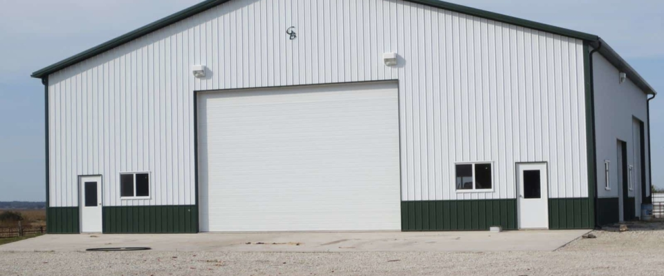 large white machine shed building