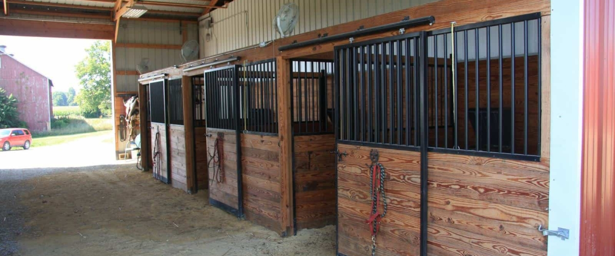 pole barn horse stable with outdoor riding arena