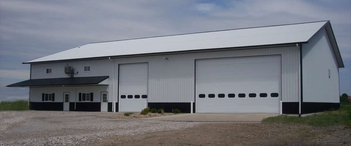 white insulated pole barn shop with office space
