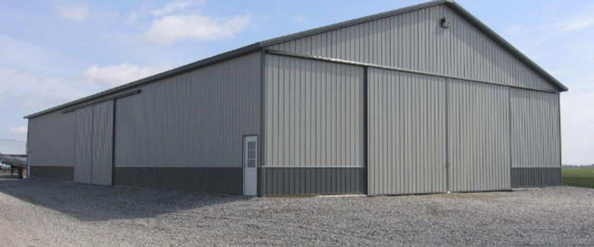 large gray machine shed building