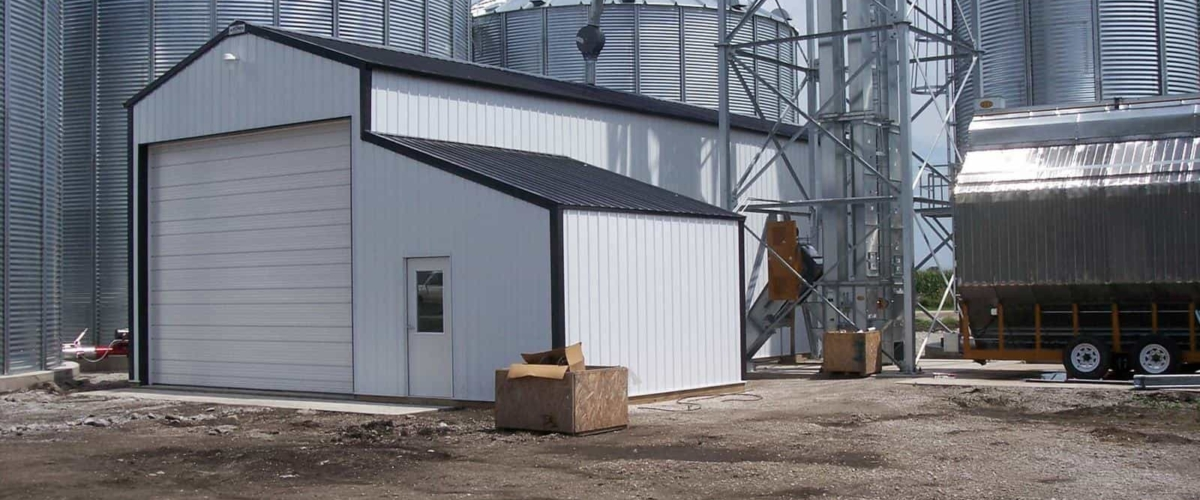 small white machine shed storage building