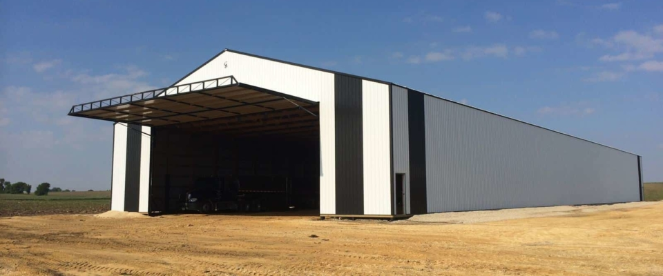 white and green machine shed large hydraulic door