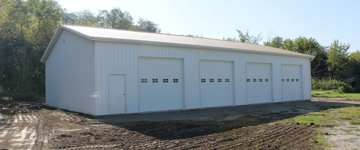 large white machine shed 4 overhead doors