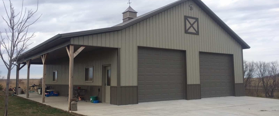 tan and brown pole barn garage two doors