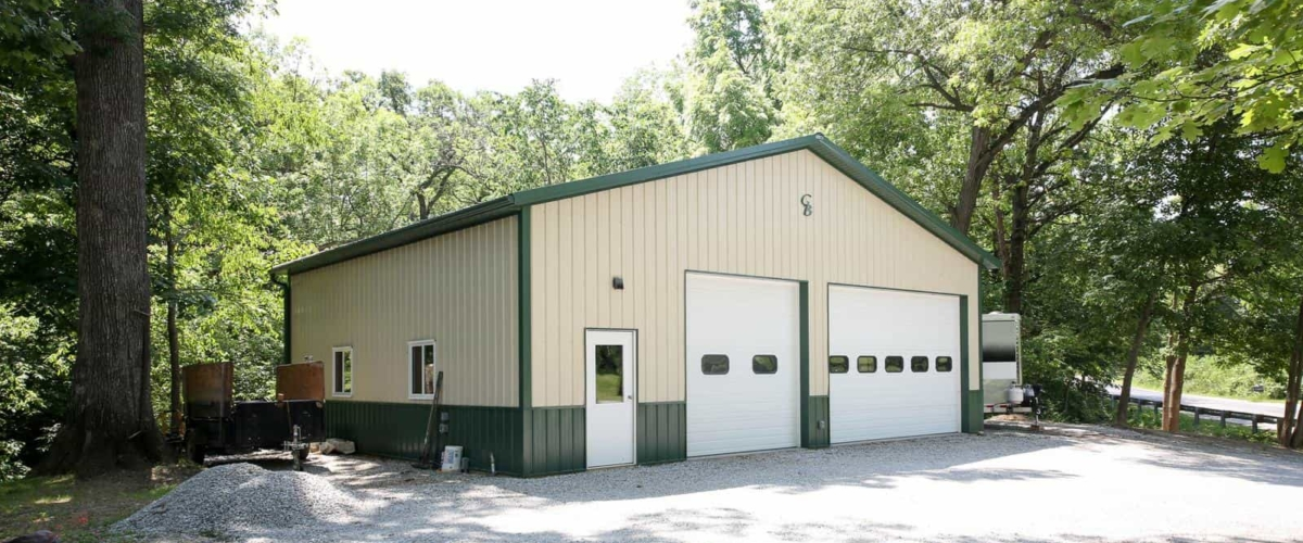 green and cream pole barn garage