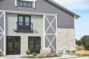 Fairfield Iowa Post Frame Buildings by Greiner Buildings Gray and stone wainscoting pole barn