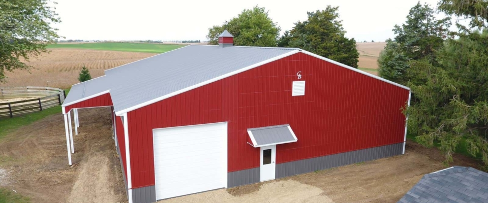 red post frame building horse barn