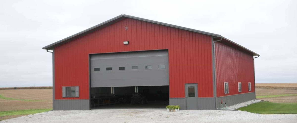 red farm workshop building with large door