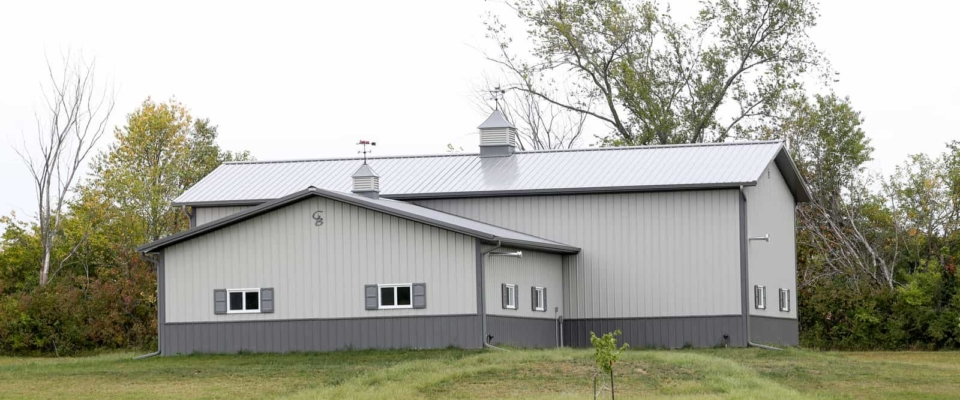large white and gray pole barn garage shop