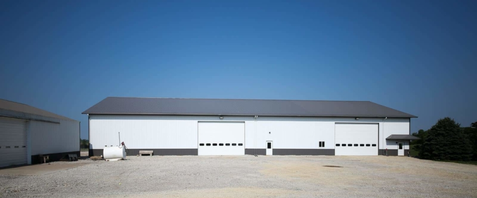 white and gray pole building on farm