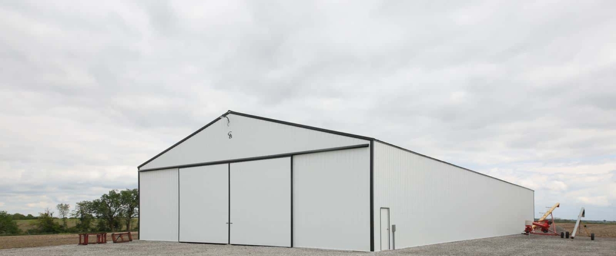 white machine shed building on farm