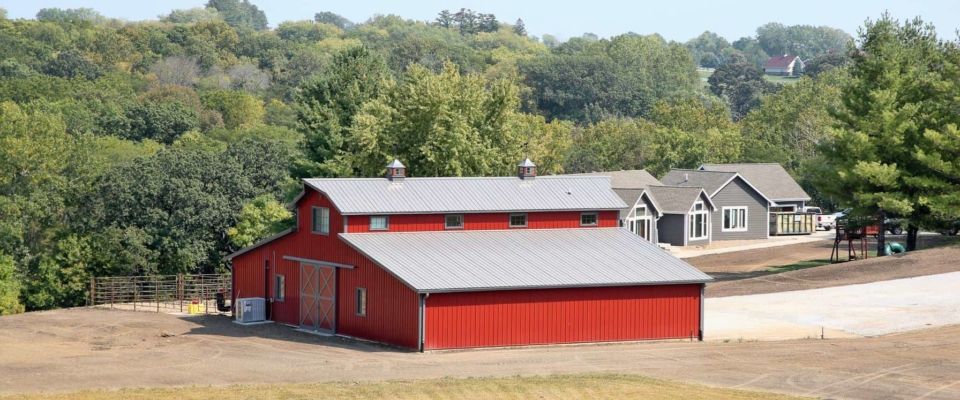 large red equestrian barn