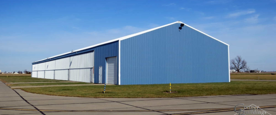bright blue airplane hangar post frame building