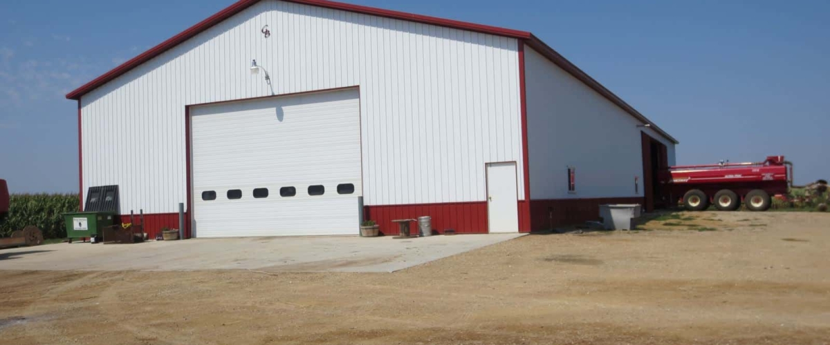 large white and red farm shed building for tractors and ag equipment