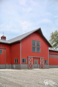 Award Winning Post Frame Machine Shed Red with Smoke wainscot and roof in Prairie City