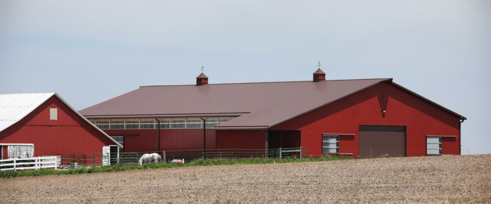 large post frame equestrian building red