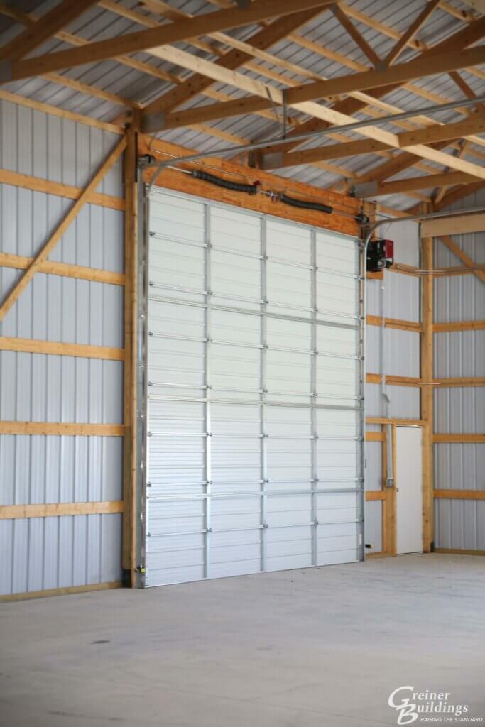 large overhead door inside pole building garage
