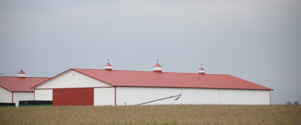 large red and white machine shed on iowa farm