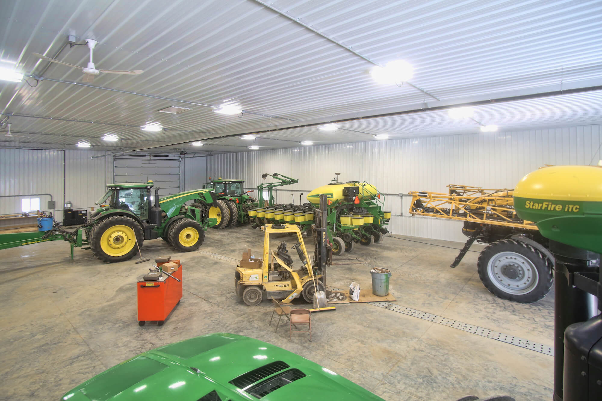 inside a greiner lined shop with farm equipment